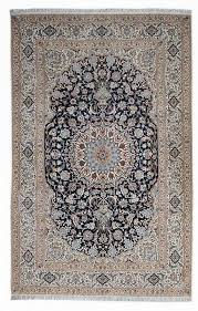 a very finely woven wool and part silk persian rug from the central town of nain with a classic foliate medallion design
