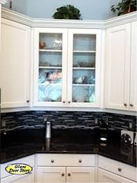 Add Glass To Kitchen Cabinets To Add Interest To The Kitchen
