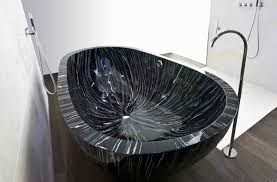 unique bathtub design ideas black natural stone bathtub with standing brushed nickel faucet on wooden floor