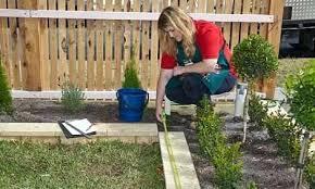 diy irrigation system woman measuring up the garden diy drip irrigation system pvc