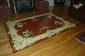 hand painted rug on a wood floor dining room