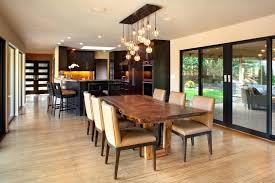 kitchen table chandelier height over contemporary with ceiling lighting dark image by wood slab dining best kitchen table chandelier