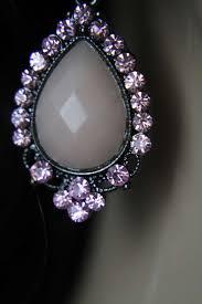 pale pink teardrop dangle earrings w pink rhinestone dotted black filigree frame