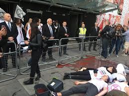 London <b>Fashion</b> Week: Extinction Rebellion protesters soak ...