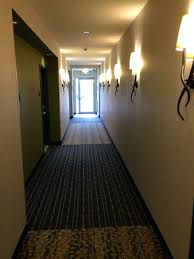 Hotel hallway lighting ideas Carpet Lighting For Hallways Garden Inn Airport Hotel Lighting Hallways Nicely Decorated And Clean Lighting For Hallways Zacharyseligcom Lighting For Hallways Modern Hallway Lighting Design Ideas For