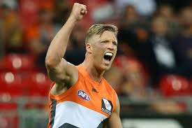 greater western sydney giants midfielder rhys palmer celebrates scoring a goal with his fist in the