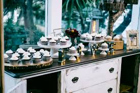 delicious cupcakes set at the entryway to the reception area for guests to help themselves