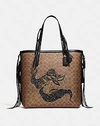 TOTE 34 IN SIGNATURE CANVAS WITH TATTOO ...