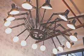 and i am in love with this chandelier made from 16 swing arm lamps