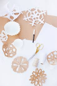 make these modern paper snowflakes for your home this winter using diffe textures is a