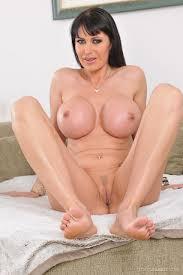 Shaved Curvy Eva Karera with Fake Tits Wearing Platform High Heels.