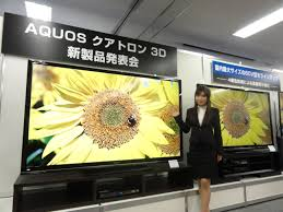 Larger than life: A model shows off Sharp\u0027s new 80-inch television, which features the largest display panel on domestic market, during a news Sharp unveils TV market | The Japan Times