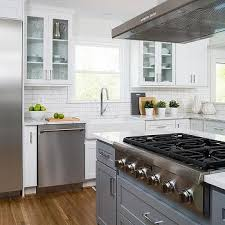 dark gray island with thermador cooktop