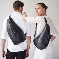 leather healthy back bag classic medium in black on a man and woman