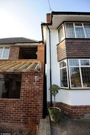 the whites say they are now unable to maintain their wall and guttering problems could damage