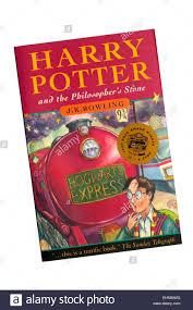 a paperback copy of harry potter and the philosopher s stone by j k rowling stock