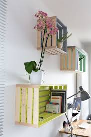 Wood crates painted on the inside with pastel colors made into shelves