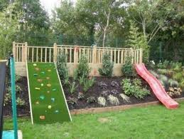 Backyard fun for kids. Play structure slide and climbing wall. Great idea  for sloping yards. More like backyard fun for me.