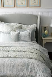 Toile bedding with gray wing headboard