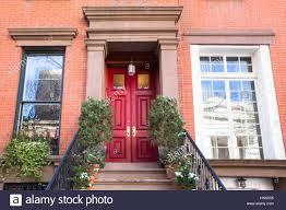 city apartment building entrance. stock photo - typical entrance door to a new york city apartment building residential home alamy