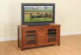 enchanting walnut finish wood tv stand featuring double glass door cabinets and 3 small rectangular