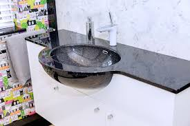 vanity top in black sparkling granite and an integrated oval basin
