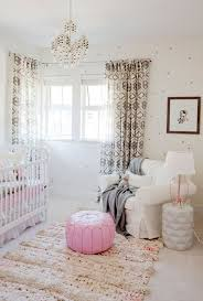 round pink rugs for nursery with eclectic nursery also pink accents pink pouf small chandelier wallpaper