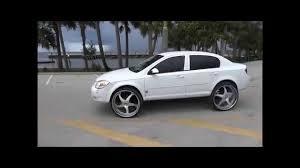 Chevy cobalt On 26's Forgiatos - YouTube
