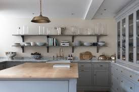 Image Interior Design White Kitchen With Wooden Topped Island And Hanging Plants Real Homes How To Design Shaker Kitchen Real Homes