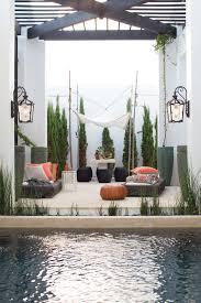 mediterranean outdoor lighting. Mediterranean Outdoor Lighting Patio With Orange Leather Pouf Hinkley Wall Lantern P