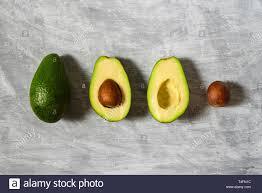 Avocado Light Avocado With Half And Seed On Light Grey Background Hard