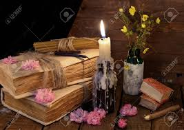 still life with old book burning candle and flowers alternative cine vine concept stock