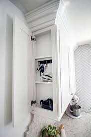 side panel on kitchen cabinet organizer with key hooks and shelves