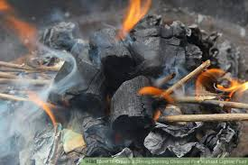 image titled create a strong burning charcoal fire without lighter fluid step 12