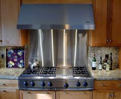 stainless steel backsplash in a traditional kitchen