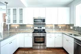 backsplash with white cabinets and black countertops black and white black and white kitchen black white grey tile white kitchen cabinets with black and