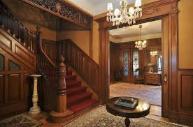 old house interiors. natural brown nuance old house interiors with white chandelier and round table on the architectural rug n