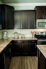 Dark Kitchen Cabinets With Light Granite Unique Arabesque Selene Tile Backsplash With Espresso Cabinets And Granite