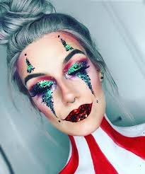 first up we have this glitter circus clown makeup plan the creative person has used the clic clown style with the eyes and lips however glammed it up