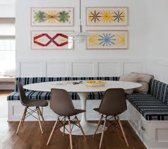 corner bench seating with saarinen tulip table and eames chairs