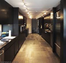 track kitchen lighting. Kitchen Track Lighting Over Modern Black Cabinet And Laminate Floor: Full Size