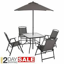 gray patio furniture set with umbrella