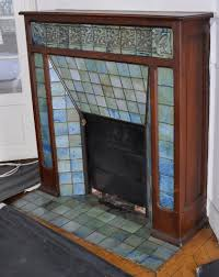 antique art nouveau fireplace with glazed stoneware tiles and shamrock decor attributed to the gentil and