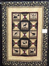Quilt Inspiration: Wine Country Quilt Show: Day 1 & This quilt features a very outsdoorsy, woodlands theme, where neutral tone  courthouse steps blocks are alternated with silhouettes of wildlife. Adamdwight.com