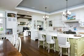 crystal chandelier over kitchen island chandelier for kitchen island here are a couple with 2 chandeliers pendant lighting for kitchen island height