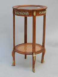 french style occasional round table with caned lower shelf 28 1 2