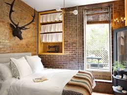 exposed brick bedroom design ideas. bedroom with exposed brick and antique decor design ideas e