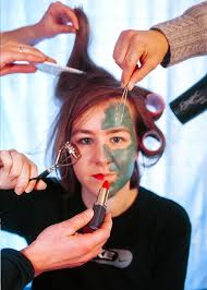 a woman applies makeup and does her hair makeup and social a can potentially both negatively affect self esteem universe photo