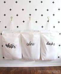 i love this space saving laundry organization idea the bag labels are so pretty