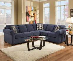 splendid navy blue fabric corner sofa with oval glass top coffee table and white rug